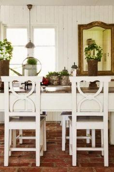 Country Dining Room with Paint, Casement, Standard height, Brick floors, Pendant light, Built-in bookshelf