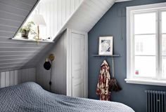 Small master bedroom in an attic space with blue and white walls. Oval Room Blue, Small Master Bedroom, Rustic Wood Walls, Swedish House, Cozy Nook, Attic Spaces, Love Home, Scandinavian Home, Room Paint