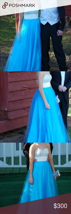 """Blue & white sparkle prom dress Beautiful ball gown style prom dress.   Blue bottom with a white sash and blue, silver and white sequins, jeweled, and beading on the top.   Strapless   Only worn 1 time for prom and has been dry cleaned !   Excellent condition !  Size 0   Dress fits with heights 5'1""""-5'7"""" depending on heel/shoe  choice Dresses Prom"""