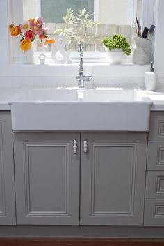 French gray kitchen cabinets. Love how clean (yet not boring) this looks!