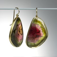 An extraordinary pair of 18k yellow gold Lola Brooks earrings with watermelon tourmaline wing slices, equaling 67.9 carats.&nbsp