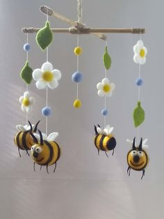 Early mobiles did not necessarily move, as do most crib mobiles today. Boho Baby Shower, Mobiles, Bee Crafts, Diy And Crafts, Flower Mobile, Baby Mobile, Hanging Banner, Felt Baby, Baby Shower Decorations