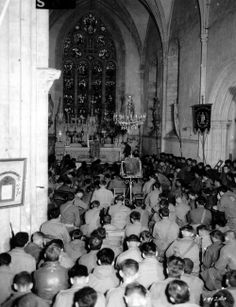 US soldiers attending Sunday mass in the church of Sainte-Marie-du-Mont, 11 June 1944.