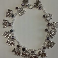 Charm Bracelet - elephants. £9.99 plus p&p. Available with your choice of coloured glass seed beads.
