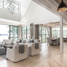 This coastal home is a dream house! Shiplap, slipcovered chairs, modern lighting, black windows - so much to love! Coastal Living Rooms, Coastal Cottage, Home And Living, Living Spaces, Decor Interior Design, Interior Decorating, Interior Livingroom, Cheap Home Decor, Home Collections