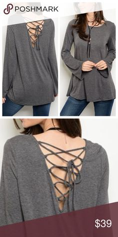 """Lace Up Tunic Bell sleeve tunic w/ edgy lace up back detail. Goes great with everything & easily dressed up or down. 95% Rayon, 5% spandex; non-sheer. S (bust: 36""""), M: (bust: 38""""), L (40"""" bust). Top has great stretch. Price firm, unless bundled. Tops Tunics"""