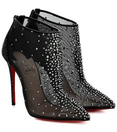 The Constella ankle boots from Christian Louboutin sit atop stiletto heels, taper to pointed toes and come finished with the label's hallmark red lacquered soles. This pair has been made in Italy from black mesh . Fancy Shoes, Crazy Shoes, Cute Shoes, Shoe Boots, Shoes Heels, Women's Boots, Pumps, Leather Midi Skirt, Dream Shoes