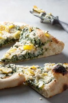 Forget take-out! Fall in love with pizza night again with this delicious dairy free, vegan friendly Spinach Artichoke Pizza on a homemade Neapolitan Crust!
