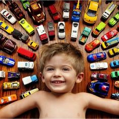 This is such a cute photo idea. :) We certainly have enough cars.