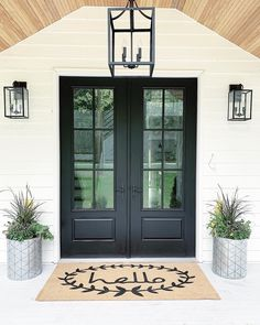 Get inspired by Farmhouse Outdoor Design photo by Room Ideas. Wayfair lets you find the designer products in the photo and get ideas from thousands of other Farmhouse Outdoor Design photos. Double Front Entry Doors, Front Door Entrance, Front Door Lighting, Porch Lighting, Front Porch Lights, Modern Farmhouse Plans, Farmhouse Front, Black French Doors, Porch Doors