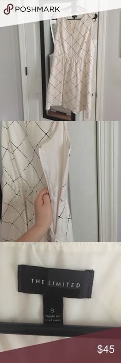 The Limited Geometric Dress Fun geometric office dress with side zip! Slight V neck but nothing super show-y. Great with heels and a long black coat. Worn a few times but white doesn't look very good on me. MAKE AN OFFER. The Limited Dresses