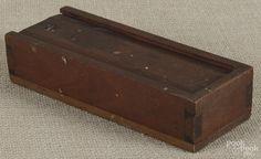 Pennsylvania walnut slide lid pencil box, 19th c., 1 3/4'' h., 8'' w., 3'' d. - Price Estimate: $40 - $60
