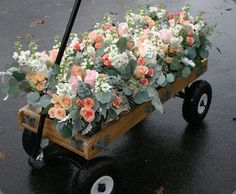 transport Lauren-wagon wild bunch studio transporting flowers from vehicles to the venue on wagons