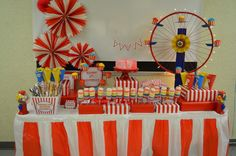 Love the box idea for the food table, the mini bunting on the cake and the rosettes on the wall!  Cute
