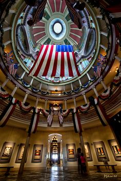 This is the rotunda of the Old St. Louis Courthouse in St. Louis, Missouri, decked out for the 4th of July. The Old St. Louis County Courthouse was built in 1828 as a combination federal and state courthouse in St. Louis, Missouri. From 1864 to 1894 it was Missouri's tallest habitable building. It was designed by the firm of Lavielle and Morton, which is reported to be the first architect firm west of the Mississippi River above New Orleans.