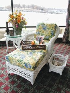 White wicker chaise lounge belongs in cozy sunrooms like these! #white #wicker #chaise #floral #sunroom pinned by wickerparadise.com