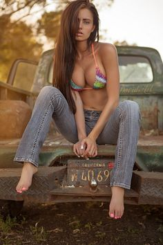 Sexy woman with rusty old truck. Calendars of cars and chicks at http://www.car-calendars.com/auto-models-calendars.htm