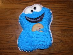 Cookie Monster Holding a Chocolate Chip Cookie Cake