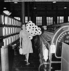 """Cotton worker Mrs Bannister carries 14 large bobbins in one arm and 1 in the other hand!) from the """"intermediate to the roving frames"""" at a cotton mill, somewhere in Lancashire. Uk History, History Images, British History, History Facts, Northern England, England Uk, Cotton Mill, Cotton Plant, Rochdale"""