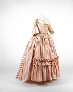 1785-1787, France. Robe à l'Anglaise. In eighteenth-century dress, the torso was encased by layers of quilted linen and boning that constitute an exaggerated exoskeleton. An inevitable consequence of this redefinition of the torso is an emphasis on the hip and bustline. By mid-century, especially in France, the style was for the bust, veiled by lace or a sheer mull fichu, to emerge above the top line of the bodice.