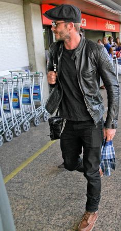 Once Beckham find things that he likes then he does again in different ways - all black outfits with brown shoes (check), hats (check)