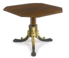PROPERTY OF A LADY An Austrian neoclassical parcel-gilt and part-ebonized mahogany center table early 19th century