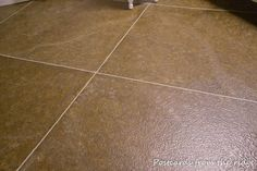 Faux painted tile floor with tutorial.  Gives tips on how to paint & use sponge