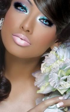 Love the blue eyeshadow.