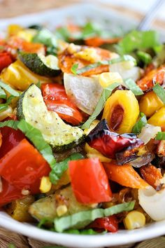 Roasted Summer Vegetables ♦ red bell pepper, yellow bell pepper, zucchini, carrots, olive oil, Italian seasoning, kosher salt, freshly ground black pepper, fresh corn, yellow or red onion, minced garlic, Sargento® Shredded Reduced Fat 4 Cheese Italian, fresh basil leaves...