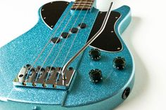 Blast Cult Thirty 2 Bass with tremolo $3450 A neat single cut, medium scale bass guitar. I really dig the color and I'm curious about the pickup. This one has a Hipshot bass tremolo too. I really dig the subtle widening of the raised center to accommodate for the bridge plate.