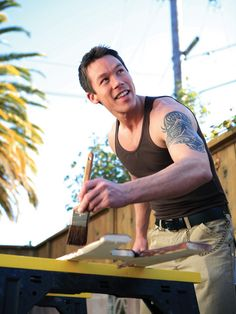 A hot guy with a cool tattoo and a paintbrush in his hand - Is there anything sexier???  Love David Bromstad!