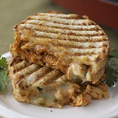 Shredded chicken in a from-scratch sauce flavored with chipotle and cumin, cooked in a cheesy panini with cilantro.