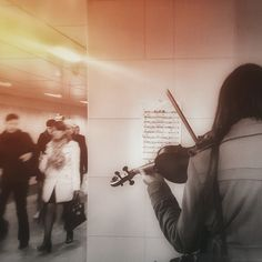 #Moscow: A young woman, probably a student, was rehearsing at a city #subway station. She wasn't playing for money, nor for people's attention. No one could see her face. She would just put her sheet #music on the wall and #repeat the part over and over. Photo taken by Nadya Bobkova. #localculture #localmillennials #comissionculture