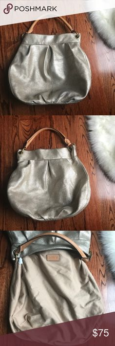 J. Crew Gold Leather Metallic Hobo Handbag For Sale:  Amazing J. Crew large gold metallic leather hobo handbag   This is probably one of the best handbags I've ever owned. The metallic leather is so amazing! It's so soft, and just an overall great hobo. Very clean in the inside and outside. J. Crew Bags Hobos