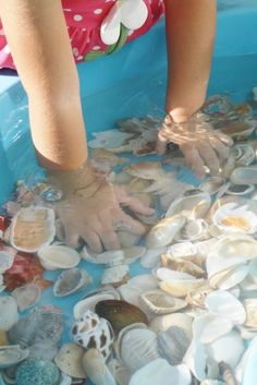 Shells and Water Toddler Play. This would keep children of all ages entertained for quite a while :)