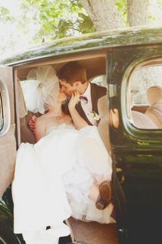 love her hat, the vintage car, and his purple bow tie!