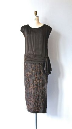 Vintage 1920s dark chocolate brown silk dress with tunic top, drop waist with wrapped sash, heavily beaded skirt and complete under dress layer with side snap closures.