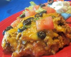 Fantastic Taco Casserole. I didn't use olives, but I followed most of the rest of the recipe. Used my homemade refried beans and black bean corn salsa. Used tostada shells on the bottom- worked perfectly!