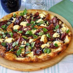 Caramelized Pear and Prosciutto Pizza - inspired by a favorite restaurant gourmet version, this recipe proves that you really can make the best thin crust pizza at home. The combination is sweet and salty with the creamy pungency of the cheese and a finishing drizzle of reduced balsamic vinegar completing an unusual but absolutely delicious flavor combination.