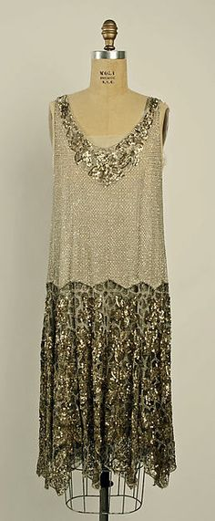 Evening dress Date: 1926–27 Culture: French Medium: cotton, beads Accession Number: C.I.53.9.1a, b