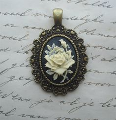 Gothic victorian rose cameo pendant by LeanderOrnaments on Etsy, $4.25