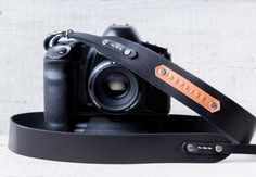 D E S C R I P T I O N: Hand made personalized leather camera strap belt. Black color.  Unisex.  Strap is designed hand made in our studio. Fits all