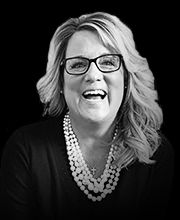 Ronda Conger, Vice President, and resident Red Bull drinker. This fire ball inspires and leads the troops daily!