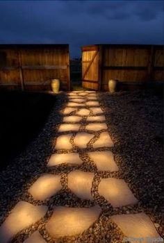 """Line a pathway with rocks painted in glow in the dark paint. During the day they """"charge"""" in the sun and in the evening they reflect the stored light."""
