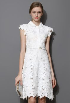 This belted white shift dress is a awesome choice to team with your heels. Cut to above knee length, all flower cut out construction with a slim belt accenting the silhouette. - Concealed snap fastening on upper front - Concealed side zip closure - Lined, with belt - 100% Cotton - Hand wash Size (cm) Length Bust Waist XS      98     84   62fits for US0/0 UK2/4 EU30/32 S       99     88   66 fits for US0/2 UK6/8 EU34/36 M      10...