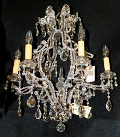 Six arm Italian iron and crystal antique chandelier. #antique #chandelier #iron #crystal