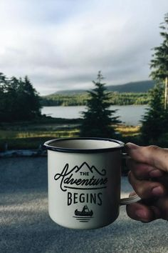 A hand holding a coffee mug in front of a road pine trees and river in Vancouver  Pinterest // carriefiter  // 90s fashion street wear street style photography style hipster vintage design landscape illustration food diy art lol style lifestyle decor street stylevintage television tech science sports prose portraits poetry nail art music fashion style street style diy food makeup lol landscape interiors gif illustration art film education vintage retro designs crafts celebs architecture…