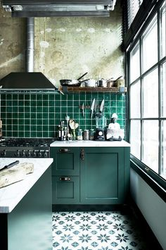 Kitchen Interior Design Industrial chic kitchen with green kitchen cabinets and green square tiles - There's one look our editors agree isn't going anywhere: industrial design. Here's how to re-create the hip loft look and warehouse style at home. Green Kitchen Cabinets, Farmhouse Kitchen Cabinets, Kitchen Tiles, New Kitchen, Vintage Kitchen, Kitchen Decor, Kitchen Units, Dark Cabinets, Kitchen Plants