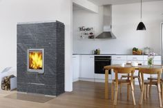 Sarmi's simple design and dimensions suit many different interior styles. The Sarmi fireplace range have a vertical firebox door that helps brings the atmosphere of the fire into the room. The large dimensions of the Sarmi fireplace range make them very effective at providing heat. The Sarmi can also be equipped with a heat exchanger and can therefore be connected to your home's hot water central heating system.
