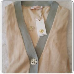 Tory Burch Jeanne Cardigan Lovely contrast in colors, large buttons with front slip pockets, great as cardigan or dress with a thin belt over skirts or pants, just timeless and versatile. Extra button attached. Size XL but large fits. Tory Burch Tops